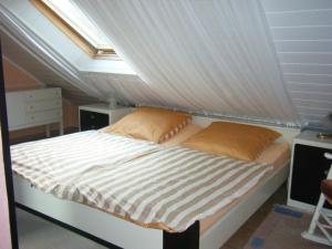 Ein Bett oder Betten in einem Zimmer der Unterkunft Ferienwohnung M. Lemmermeyer