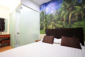 Letto o letti in una camera di Rain Forest Hotel