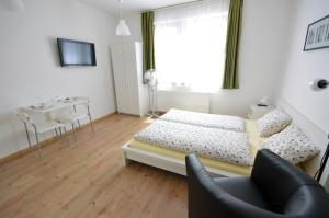 A bed or beds in a room at Toldi Apartments Pécs