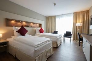Ein Bett oder Betten in einem Zimmer der Unterkunft Best Western Premier Hotel Alte Mühle