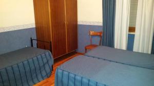 Letto o letti in una camera di Hotel Piemonte
