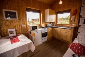 A kitchen or kitchenette at Hestasport Cottages
