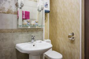 Ванная комната в Apartment Soft near Grinvich