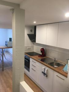 A kitchen or kitchenette at Les Appartements de Home Petite Venise