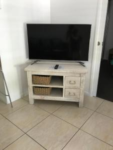 A television and/or entertainment center at 29 Aqua @ Mantra Aqueous on Port