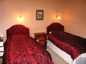 A bed or beds in a room at St. Winifreds Hotel