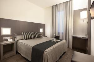 Cama o camas de una habitación en Dalia Ramblas