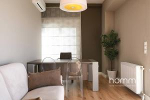 A seating area at 142m² Bright Alimos Apartment with Marina View