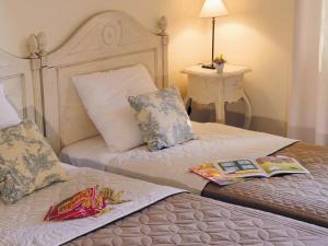 Un ou plusieurs lits dans un hébergement de l'établissement Lagrange Prestige Le Claux Du Puit