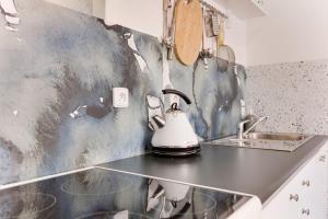 A kitchen or kitchenette at Charles Bridge Loft