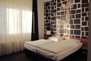 Ein Bett oder Betten in einem Zimmer der Unterkunft Hotel Hamburg-Wittenburg van der Valk