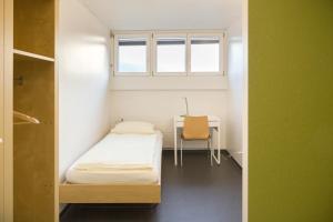 Ein Bett oder Betten in einem Zimmer der Unterkunft Bellinzona Youth Hostel