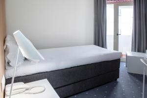 A bed or beds in a room at Stay Hotel Faro Centro