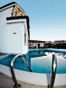 The swimming pool at or near Dolce Vita Boutique Hotel