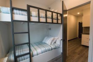A bunk bed or bunk beds in a room at The Burfield