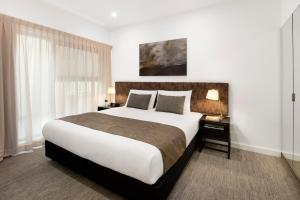 A bed or beds in a room at Quest Newcastle West