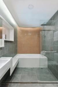 A bathroom at alia damansara by Subhome