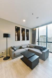 A seating area at alia damansara by Subhome