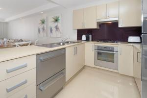 A kitchen or kitchenette at Ocean Views Shore to Please
