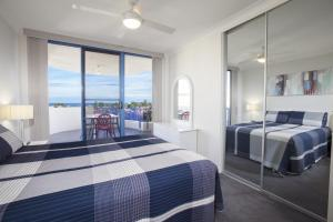 A bed or beds in a room at St Tropez Unit 37 - The Entrance, NSW