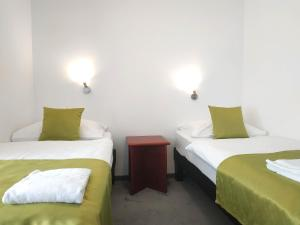 A bed or beds in a room at Hotel Orel