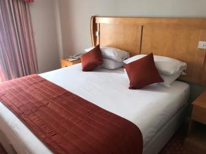 A bed or beds in a room at Lakeside International Hotel