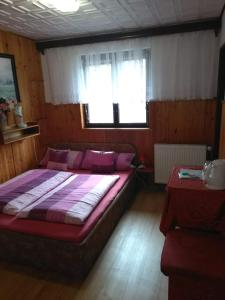 A bed or beds in a room at Pension Nika