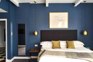 A bed or beds in a room at ABode Manchester