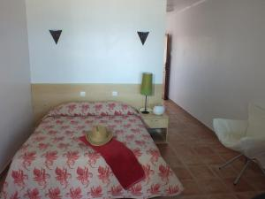 A bed or beds in a room at Hotel-Motel Agosta Plage