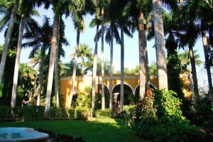 A garden outside Hacienda Chichen Resort and Yaxkin Spa