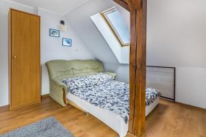 Łóżko lub łóżka w pokoju w obiekcie Sloneczny Zakatek