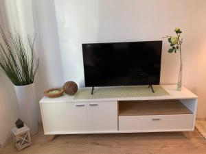 TV a/nebo společenská místnost v ubytování Cityroom