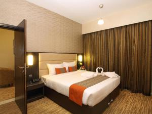 Postelja oz. postelje v sobi nastanitve Florida Al Souq Hotel (Previously Known Flora Al Souq Hotel)