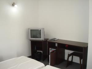 A television and/or entertainment center at Pension Oasis