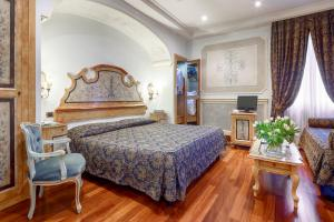 A bed or beds in a room at Hotel Villa San Pio