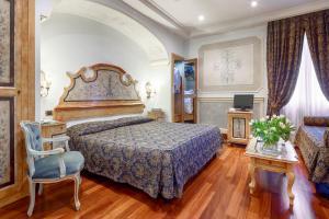 Cama o camas de una habitación en Hotel Villa San Pio