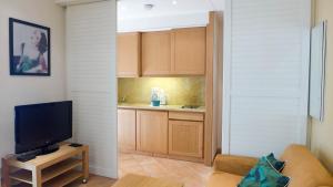 A kitchen or kitchenette at Résidences Cresci