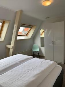Een bed of bedden in een kamer bij Stadslogement By Peek