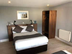 A bed or beds in a room at Aran Islands Hotel