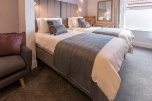A bed or beds in a room at Caythorpe House