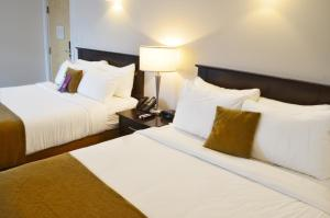 A bed or beds in a room at Coast High Country Inn