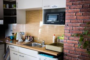 A kitchen or kitchenette at Hotelik Okęcie 39 - free transfer to airport
