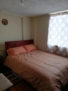 A bed or beds in a room at Estamos atendiendo - Casa en Ficoa