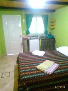 Una cama o camas en una habitación de Departamento Capilla