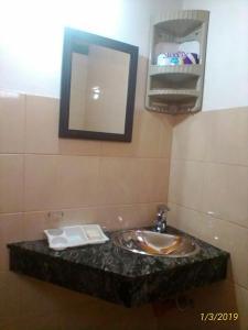 Un baño de Departamento Capilla