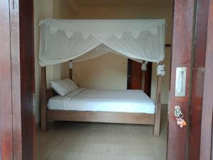 A bunk bed or bunk beds in a room at Adila Warung and Homestay