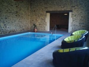 The swimming pool at or near Les Champs du Douits