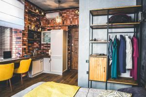 A kitchen or kitchenette at Secret Apartments of VL