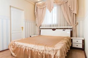Кровать или кровати в номере Apartment Nikolaeva 5