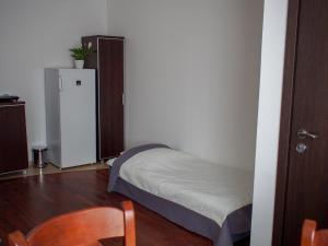 Łóżko lub łóżka w pokoju w obiekcie Noclegi Pod Brzozami